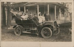 Touring Car Full of Well Dressed Folks Postcard