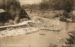 Aerial view of Russian River beach, boats, diving pier, beach goers