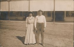 Couple standing in road Postcard