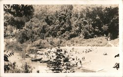 A picture of people leaving canoes on a river Postcard