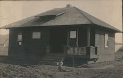 A child sits and Plays in the front yard of a home in Santa Rosa, California Postcard