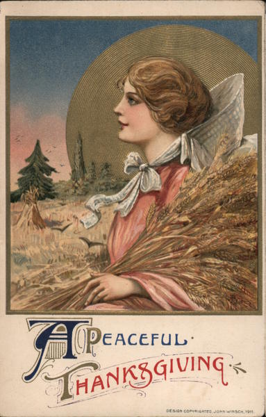 A peaceful Thanksgiving. Woman holding wheat sheaves in field.