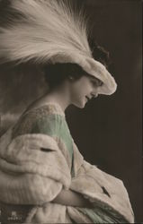 Woman in green dress with white feathered hat Postcard
