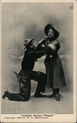 Cowboy Series Roped Cowboy on knees in front of woman Postcard