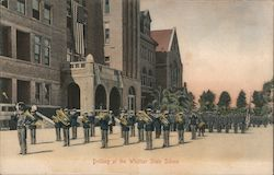 Drilling at the Whittier State School. Band and cadets. Postcard
