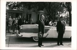 President Eisenhower standing by his motorcade car with secret service men Postcard