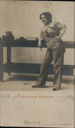 Another Worker: woman in overalls posing by a work table Postcard