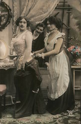 Man watching a woman getting out of dress with help of maid, Corset Postcard