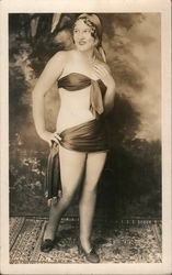 Woman with minimal clothing standing on a rug posing Postcard