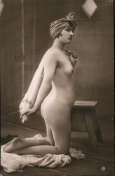 Nude woman posting with a towel Postcard