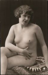 Nude woman sitting on pillow Postcard