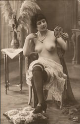 Topless woman posing with a mirror Postcard