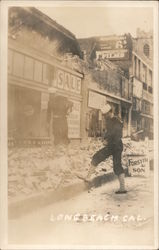Earthquake damage. Two sailors looking at street rubble. Postcard