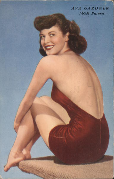 Ava Gardner MGM Pictures. Red bathing suit pose sitting on diving board
