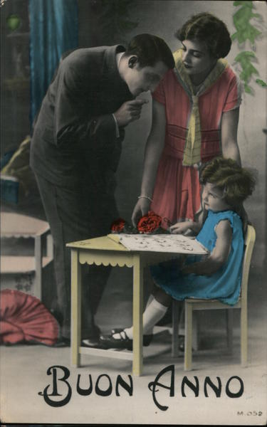 Buon Anno colorized photo man pointing finger at young girl sitting at desk.