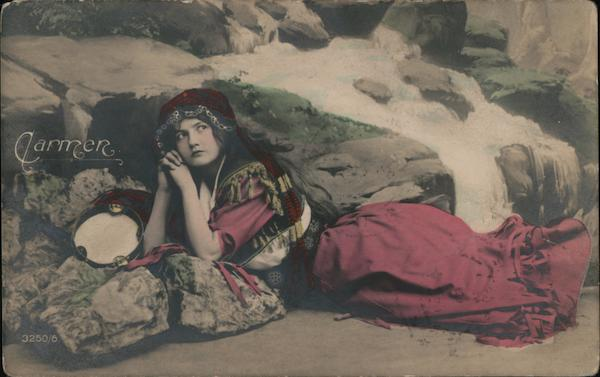 Carmen. Colorized woman in native dress, waterfall, tambourine