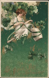 Woman riding pipe wearing white dress with green check trim, shamrocks Postcard
