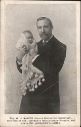 Rev. W. J. Myers (Senior Deputation Secretary) with one of the 1100 Babies Rescued from Poverty Postcard