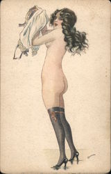 Nude woman in stockings and heels putting on nightgown signed Postcard