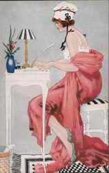Woman sitting at writing desk. Postcard
