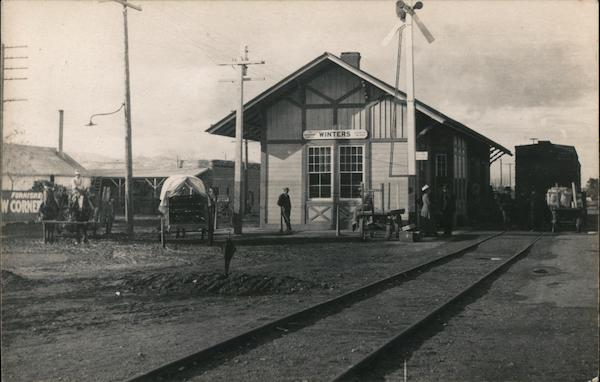 Winters train depot, horse drawn wagons, people waiting California