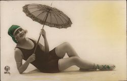 Pinup girl in swimsuit, parasol posing as if on beach Postcard