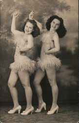 Studio photo of two showgirls in costume Postcard