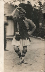 Man in highland pose with kilt and costume Postcard
