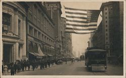 San Francisco downtown street scene with flag and streetcar, early 20th century Postcard