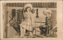 Woman on a donkey and man driving donkey cart, in sombreros Postcard