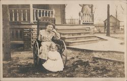 Woman in a wheelchair with a child Postcard