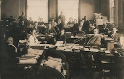 People working in office setting, typewriters, desks, file cabinets Postcard