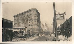 Ruins after earthquake, men cleaning street, streetcar, The Emporium. Original Photograph