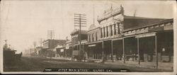 Main Street, Gilroy, California - vintage photo with horse-drawn traffic Postcard