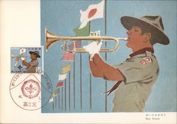 Boy Scout blowing trumpet, white gloves, row of colorful flags