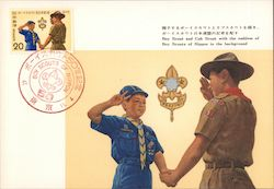 Boy Scout and Cub Scout with the Emblem of Boy Scouts of Nippon in the background