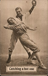 Catching a hot one. Baseball player catching ball and girl player Postcard