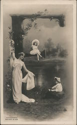 "Rotograph. Woman and children in garden with large letter ""F"" Postcard"