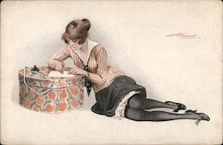 Woman writing a letter on a hat box Postcard