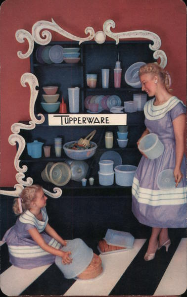 Tupperware - Two Girls Standing Next to a Cabinet Full of Tupperware