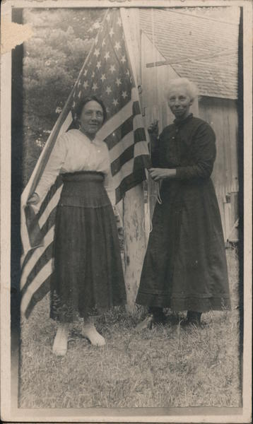 Two Women Holding Large American Flag Patriotic