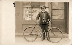 "Man with Bicycle, ""Ideal Photo Co."" storefront"