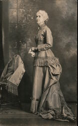 Woman in a formal gown. Message written by the woman in the photo. Postcard