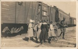 Children in front of railcars