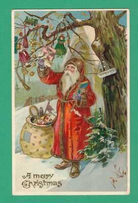 VINTAGE CHRISTMAS GEL POSTCARD SANTA PICKS TOYS FROM TREE FOR SACK NORTH POLE