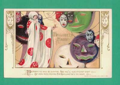 1913 WINSCH HALLOWEEN POSTCARD LADY AS GHOST WITH HALLOWEEN FACES!