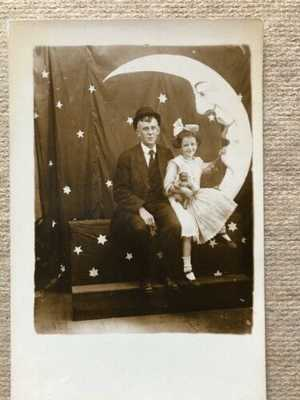 paper moon rppc little girl w black doll  & her pa  field of stars coney island