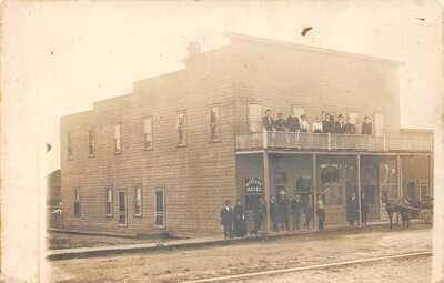 MCCOMB Mississippi postcard RPPC McColgan Hotel Front & Main Street