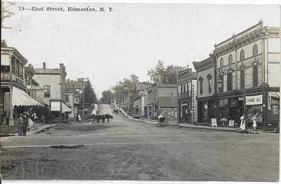 "RPPC ""19--East Street, Edmeston, N.Y."" Dirt Rd, Stores, Signs, Phelps Elite 1912"