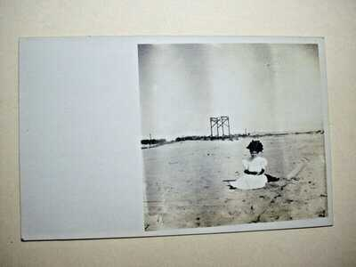 TRE 183. RPPC, Young Woman on Beach, Hueneme, Ca